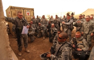 The Huddle 2nd Lt. Jason Franklin conducts a mission brief at Forward Operating Base Kalsu, Iraq, before a reconnaissance mission in Diyarah. The Soldiers are from the 4th Brigade Combat Team, 25th Infantry Division.